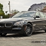 black bmw 7 series with black rims